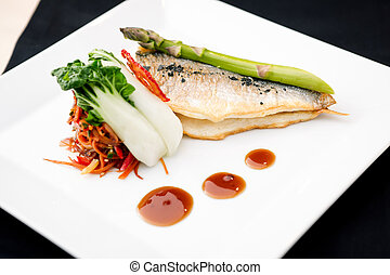 Bream fish with asparagus, vegetables, fried wok and...