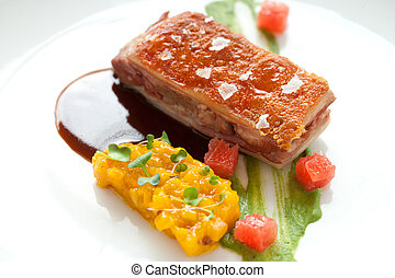 Crispy pork fillet with mango chutney. - Close up of crispy...