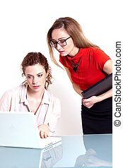 two business woman are discussing about a problem at work