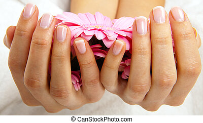 feminin hands with a treatment doing a manicure closeup