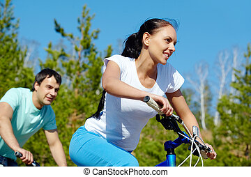 Cycle race - A young couple racing on bicycles