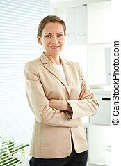 Middle aged leader - Smiling business woman looking at...