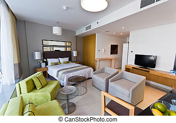 Interior of modern apartment - bedroom & lounge