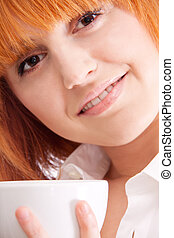 beautiful woman with red hair and a cup of tea