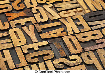 antique wood alphabet abstract - alphabet abstract in...