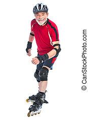 senior man inline skating - senior man goes inline skating
