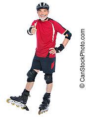 senior man inline skating