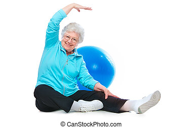 senior woman doing stretching exercises - Attractive senior...