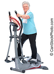 senior woman exercising on stepper - Attractive senior woman...