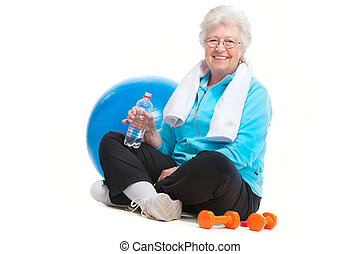 senior woman in gym - senior woman resting after exercises...