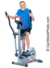 senior man exercising on stepper - Attractive senior man at...