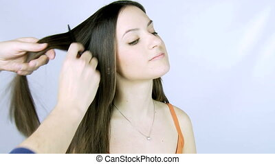 Girl getting hair ironed