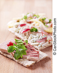 Crispbread with various toppings - closeup