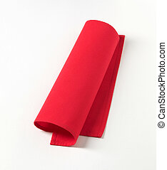 Red napkin - Small red napkin on white background - closeup