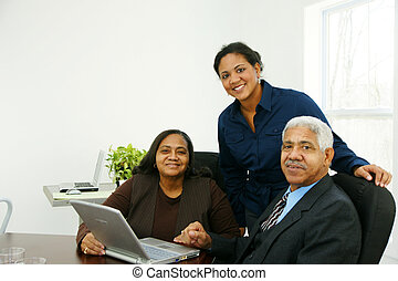 Business Team - Team of business people working together in...