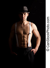men with suspenders - men in the hat on with suspenders over...