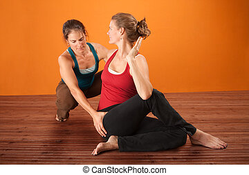 Yoga Coach With Student - Coach and student in yoga workout...
