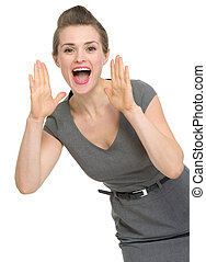 Happy woman shouting through megaphone shaped hands isolated...