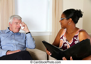 Man in Couseling - Woman Counseling a Man in Her Office