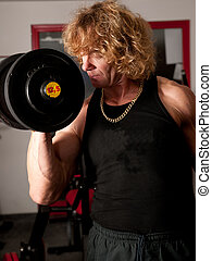 Man exercising his arm muscles by lifting two dumbell free weigh