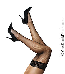 Female Legs - Sexy female legs in net stockings isolated...