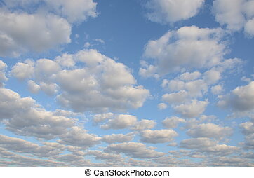 cloudy blue spring sky sun-lit background