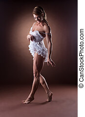sexy woman body builder undress her ballet dress