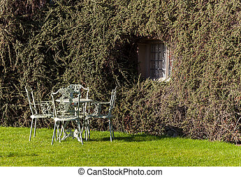Garden table and chairs on lawn