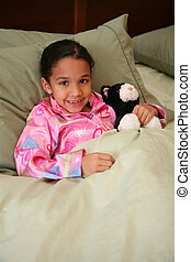 Girl Ready For Bed - Girl laying in her bed ready to go to...