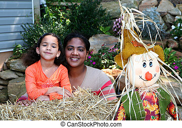 Mother and Daughter at Halloween - A mixed race mother and...
