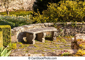 Old stone carved bench in garden