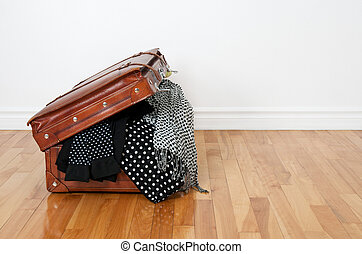 Polka dot clothing in a retro suitcase - Black and white...