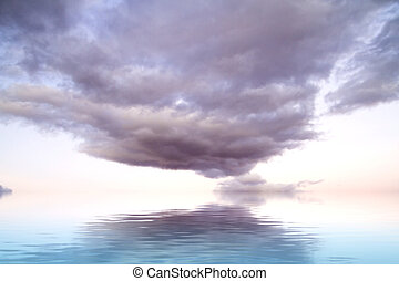 Dramatic storm clouds with water reflection
