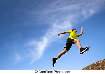young runner with cloud background