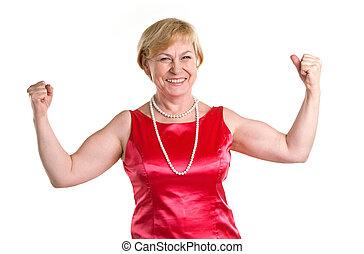Portrait senior woman - Portrait of fit senior woman flexing...