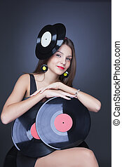 emotional girl in black dress with vinyl record - girl with...