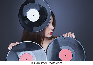 dj girl with vinyl plate - emotional brunette in black dress...