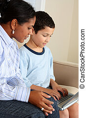 Woman and Boy On Computer