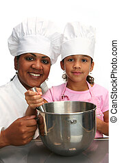Chefs - Woman with child teaching her to cook