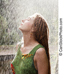Woman refreshing in the rain - Woman refreshing outdoor in...