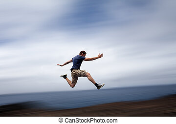 Sport and energy concept - man running fast - Sport and...