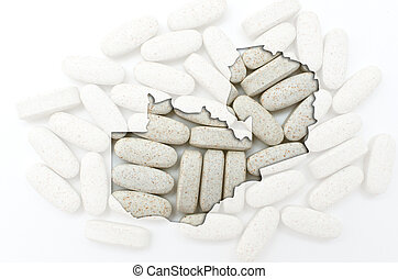 Outline zambia map with transparent background of capsules symbolizing pharmacy and medicine