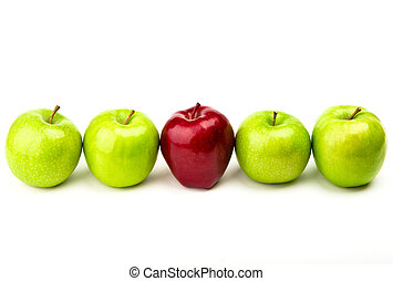 Red apple among green apples isolated on a white - Red apple...