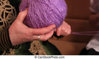 Woman rewinds yarn