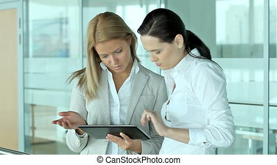 Hi-tech business women - Business ladies using a tablet pc...