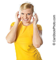 Smiling young lady listening music