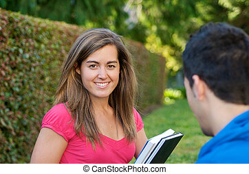 Female Student with Textbook