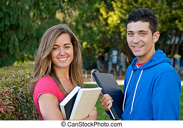 Student with Text Book - Students with text book outdoors
