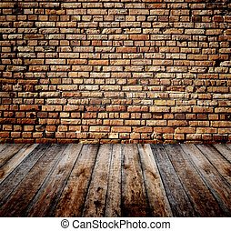 Old room with brick wall and wooden floor