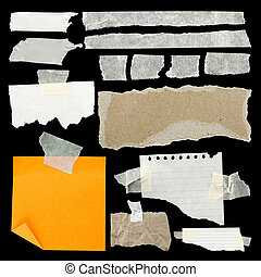 Torn paper - Pieces of torn paper and adhesive tape on black